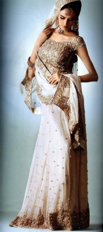 <3 pure white and gold prefect for a bride! For more follow my Indian Fashion Boards!