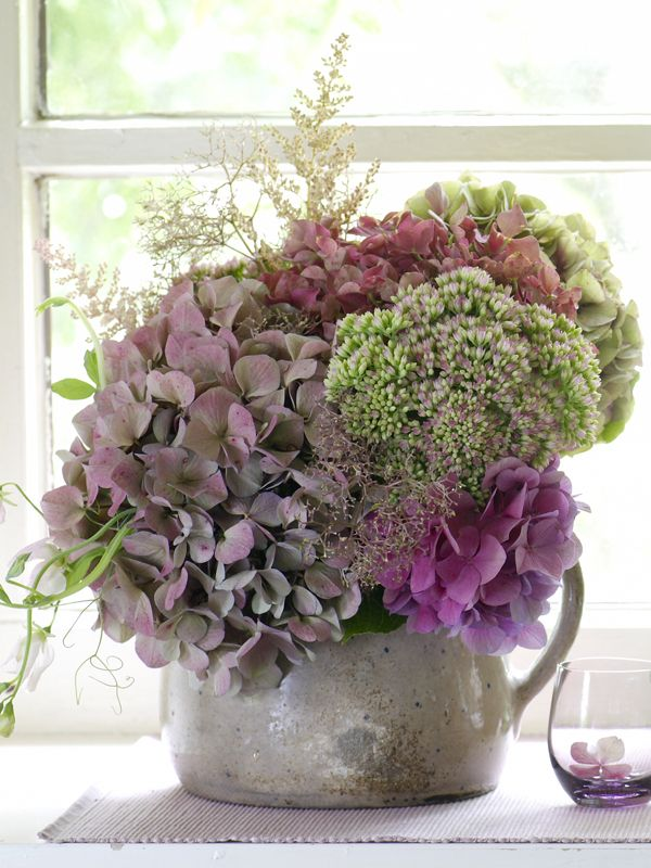 Hydrangea, sedum, fragrant sweet peas and feathery astilbe by Wohnidee