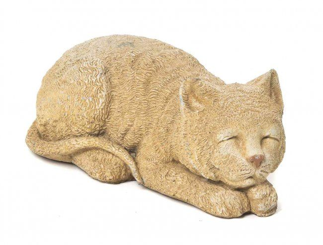 Cast in stone model of a cat, dated 1989 and signed illegibly. Length approximately 9 inches.