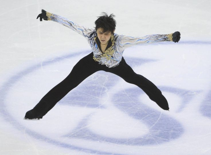 Came close: Yuzuru Hanyu performs in the men's free skate on Saturday at the World Figure Skating Championships in Shanghai. The defending world and Olympic champion took third in the free skate and finished second overall behind Spain's Javier Fernandez. | KYODO