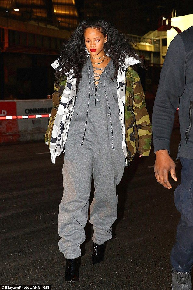Gorgeous! Rihanna bundled up in an oversize camouflage coat and massive jumpsuit for an outing in New York on Monday