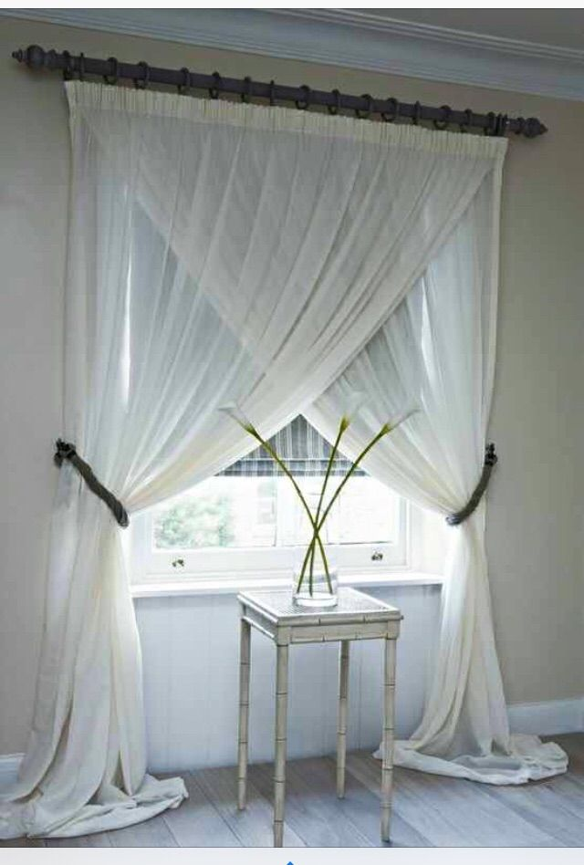 Double panel sheer curtains. Split and draped. Love the way this looks.
