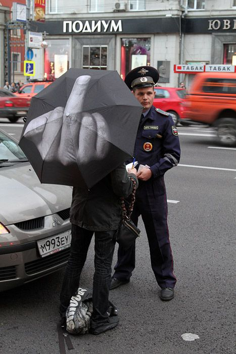 Middle finger umbrella....so inappropriate...yet so funny!  Every celebrity should own one of these for the paparazzi!