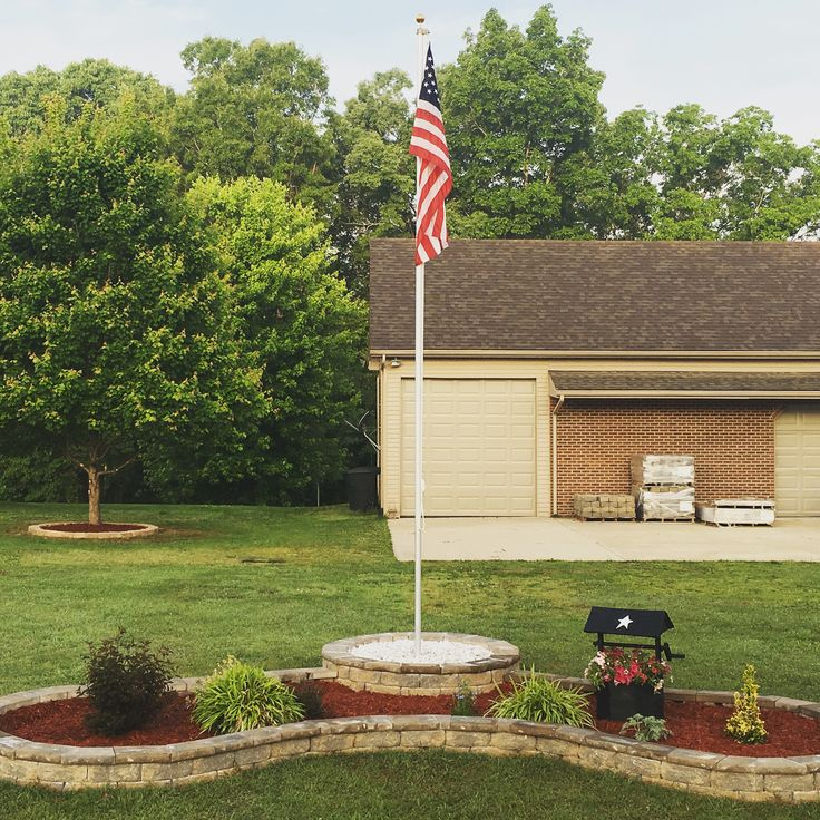 Flag pole and block flower bed