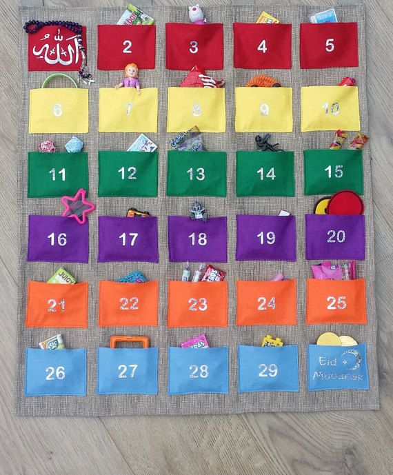PLEASE NOTE I AM FULLY BOOKED AND WILL NOT BE ABLE TO MAKE ANY CALENDARS BEFORE RAMADAN STARTS. NEW ORDERS WILL TAKE 2 WEEKS TO MANUFACTURE Stunning handmade giant Ramadan Calendar. - The size of this calendar is 91cm x 60cm. - Each of the 30 felt pockets are approx 10cm x 7cm - large
