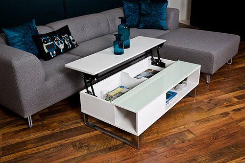 Couchtisch in hochglanz weiß, Gestell verchromt, Tischplatte teilweise aus Glas, Maße: B/H/T ca. 110/35/60 cm