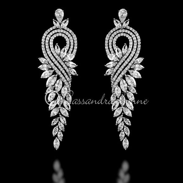 These glamorous CZ earrings will give the finishing touch to your wedding day look! Three layers of round cubic zirconia form a teardrop shape while a drape of