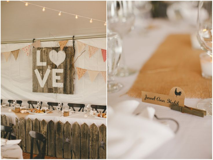 Weather barn wood picket fence head table and matching LOVE sign for this Calgary acreage wedding.