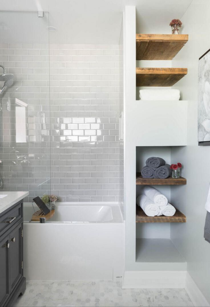Open faced linen closet with distressed wood shelves