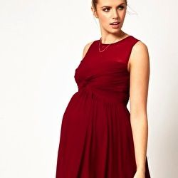 Celebrate the holidays in one of these awesome & affordable maternity dresses!