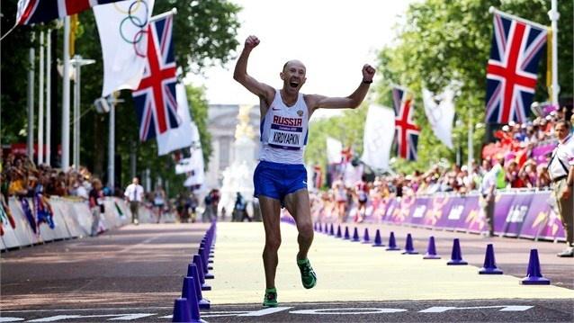 Sergey Kirdyapkin of Russia crosses the line to win gold in Men's 50km walk