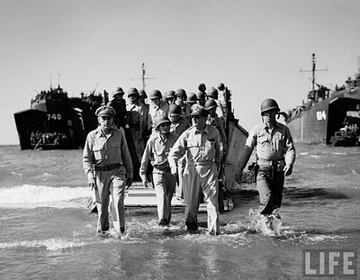 MacArthur taking the Philippines back from the Japanese.