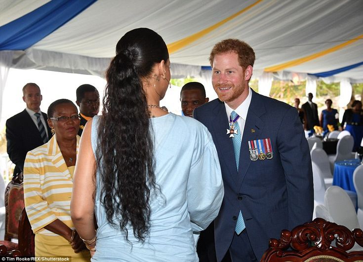 Harry looksdelighted to be introduced to the songstress at an event marking 50 years of Barbados' independence on Wednesday