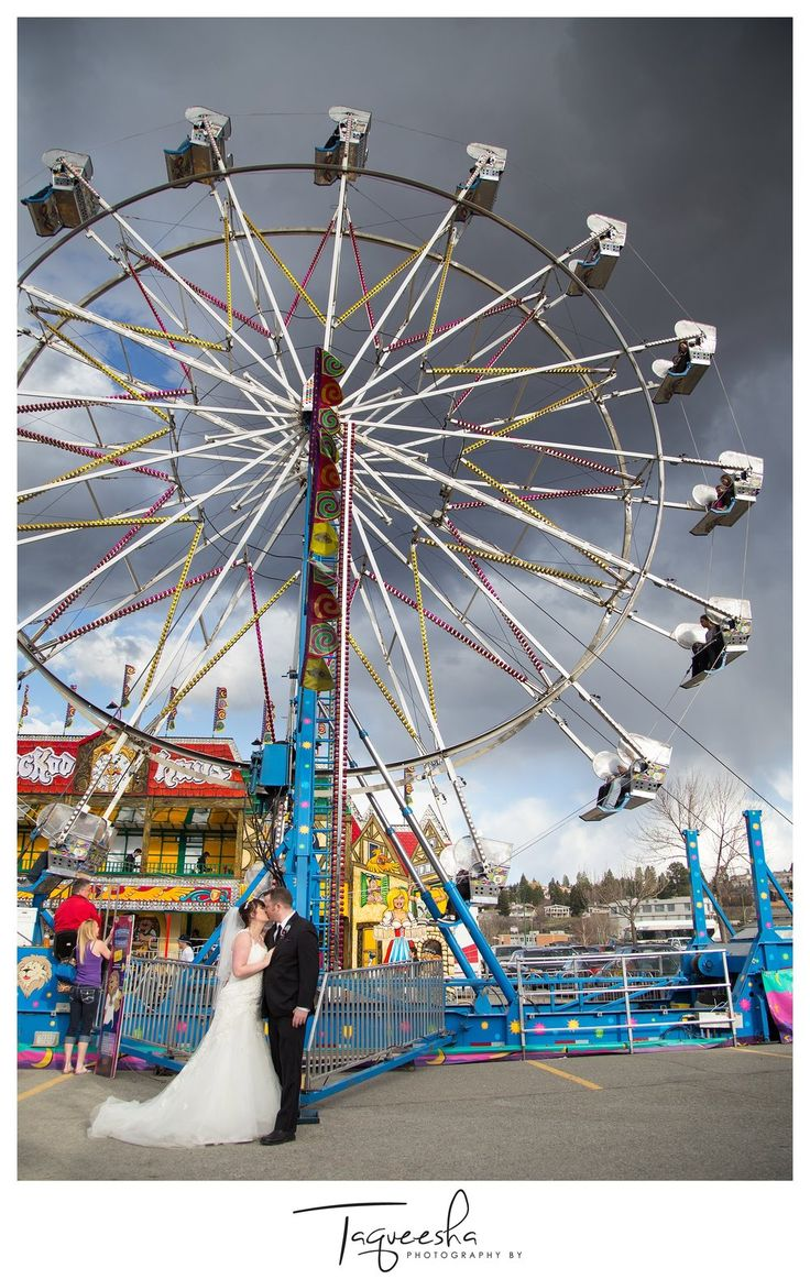 Kamloops wedding photographer, Photography by Taqueesha. Wedding photos at a carnival, wedding at a fir, couple playing games. Kissing under the ferris wheel