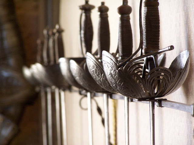 Unusual weapons rack... A beautiful offering of swords... not your basic fencing gear...