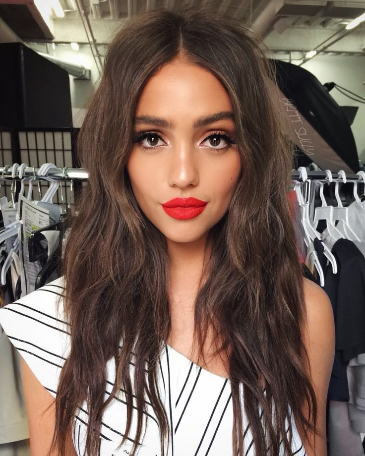 simple nude overall face with a creamy bold red lip