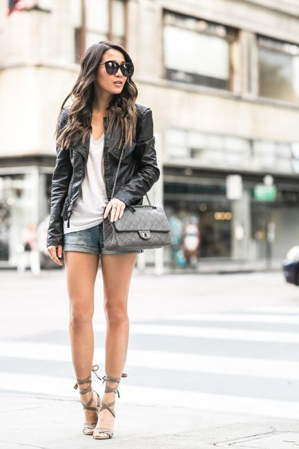 Wendy Nguyen shows us the best way to wear a leather jacket in summer; with a pair of denim mini shorts! This ultra simple (but nonetheless stylish!) look consists of a plain white tee, shorts, and a pair of neutral coloured heels. Jacket: BlankNYC, Tee: Madewell, Shorts: Levi's, Bag: Chanel, Shoes: Steve Madden.