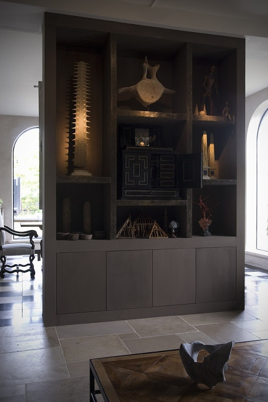 A gorgeous floating display/bookcase.  The thick shelves and frame create a strong, substantial look.