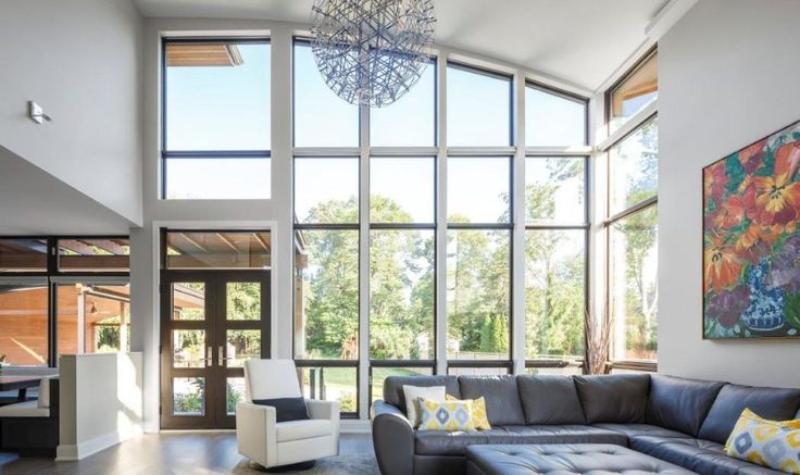 Floor to ceiling windows bring the out-of-doors into the great room.