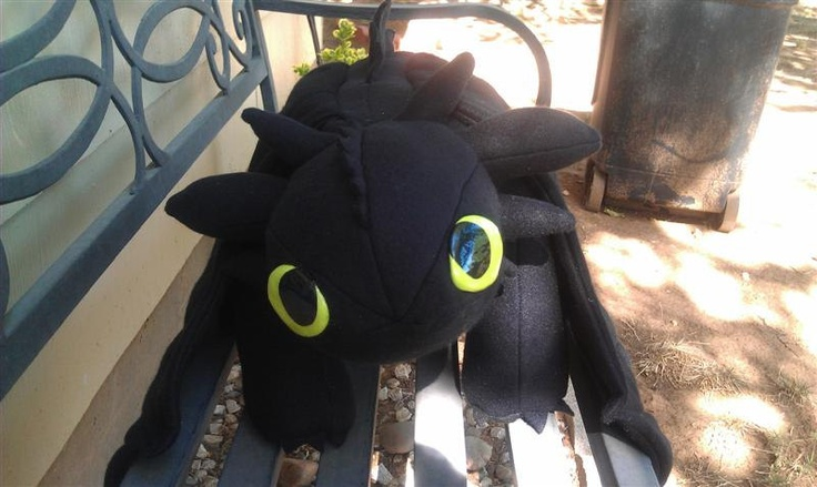 """41"""" Toothless Night Fury Dragon Plushie. it's so expensive... but it actually looks like Toothless from How to Train Your Dragon unlike the toys marketed for the movie."""
