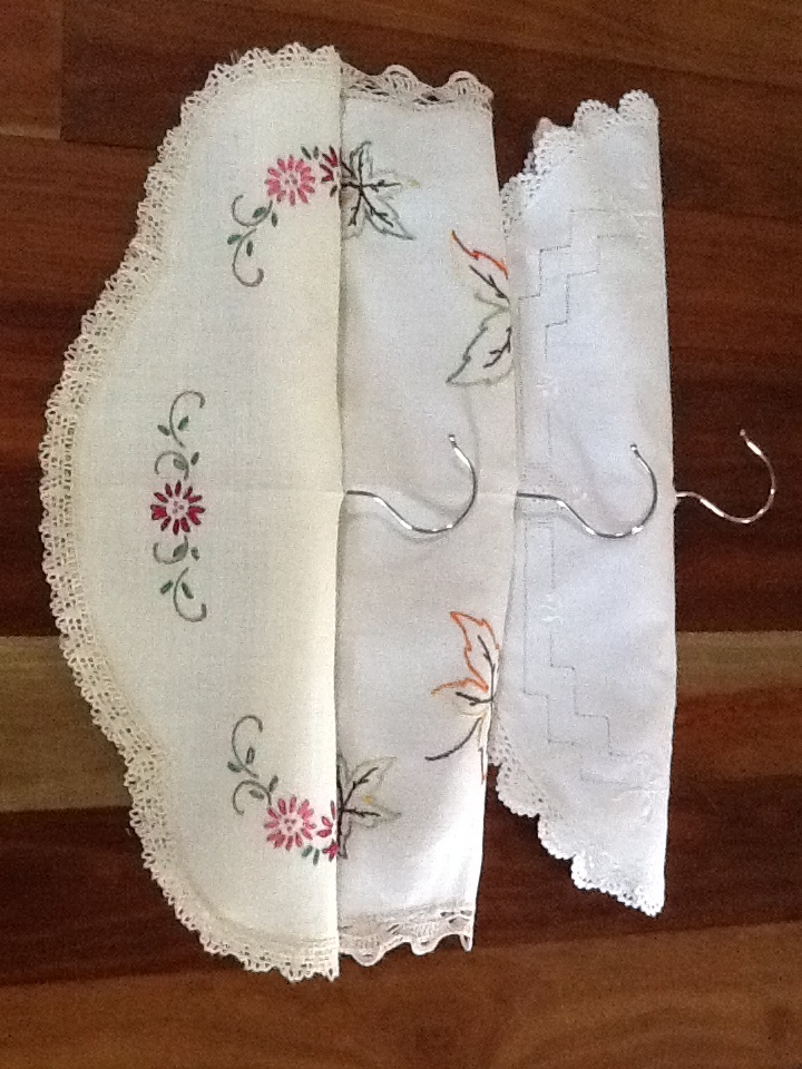 What to do with vintage doilies. Great coat hangers covers.   Just add a buttonhole and slip over padded hanger. I stitch along the bottom to keep the cover in place