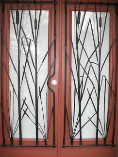 Kariton House Door  Public art found outside Kariton Gallery 2387 Ware Street, both ornamental and a security measure. Artist blacksmith, Tim Dyck is passionate about hand-forged custom iron work. He uses a forge to heat iron and when it gets hot, it becomes soft and can be easily shaped. It moves in the same way as clay. Tim uses a hammer and anvil to make one-of-a-kind pieces. Artist: Tim Dyck  installed in October 2007; unveiled in January 2008…