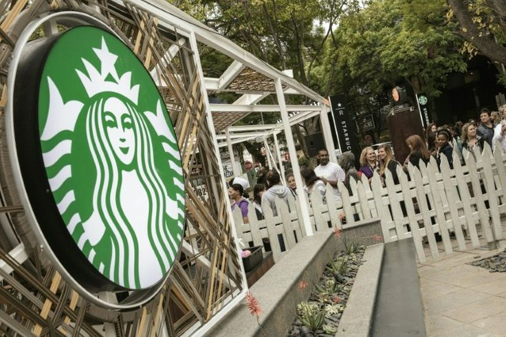 Starbucks opens first cafe in sub-Saharan Africa: People queue during the official opening of South Africa's first Starbucks store in Johannesburg on April 21, 2016