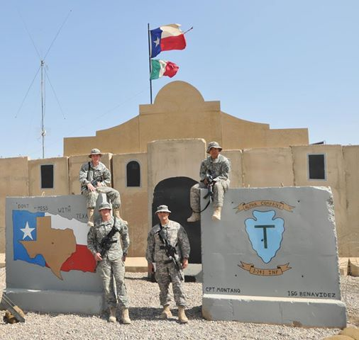 """Texas soldiers are known for taking the Texas flag into battle. This picture is of """"Alamo Crew"""" 1st Bn, 141st Infantry at Camp Liberty, Iraq. The facade of the building has been made to look like the Alamo and the Texas flag flies high. the 141st Infantry Regiment can trace its roots back to the defenders of the Alamo in 1836, hence the motto on thier distinctive unit inisgina-""""Remember the Alamo""""."""