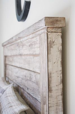 white washed headboard using white, sea green paint and gray over that