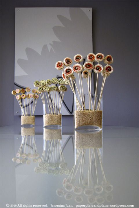 Quick, easy appetizer display: rolls on skewers, vase, rice to hold up, rice re-useable.