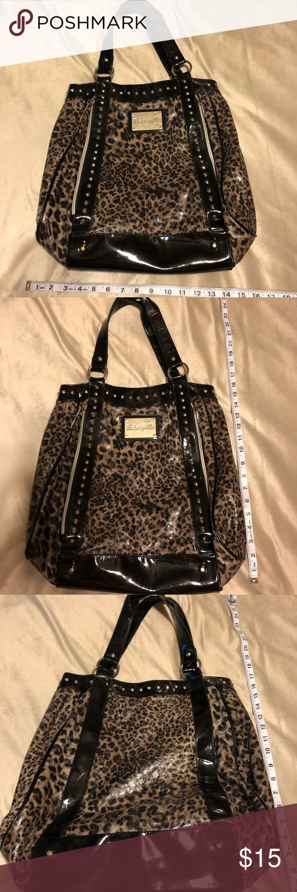 Fun animal print purse Fun animal print Betseyville purse. Super fun with zippers and spikes!! Betseyville Bags Shoulder Bags