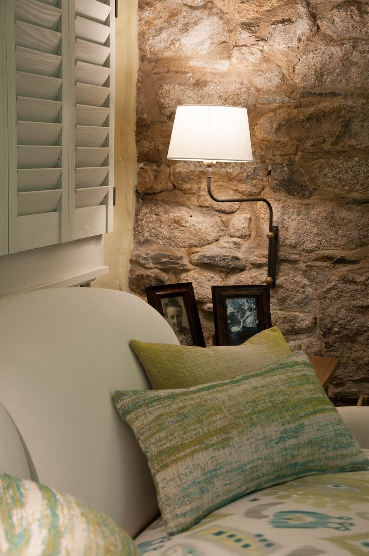 Cosy reading corner with #adjustable #swingarm #walllight seen against rustic granite elevation