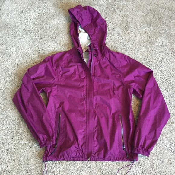 Nike windbreaker! Great purple color! Such an awesome Nike rain jacket, very thin to allow for layering while still keeping water off! A few spots on the left sleeve (pictured) and a little damage on the inner hood! Still in great condition! Nike Jackets & Coats Puffers
