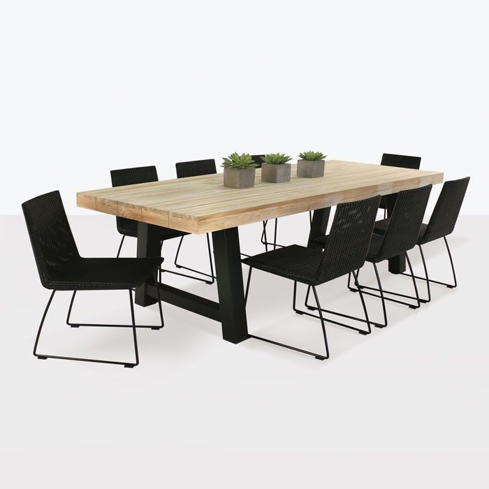 This contemporary outdoor dining set offers a beautiful trestle style reclaimed teak table and 8 chairs made from powder-coated steel and synthetic outdoor wicker. Stunning!