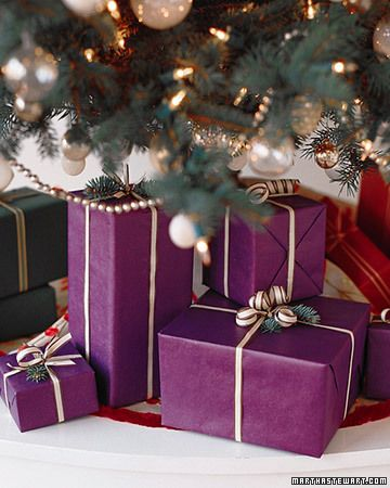 """This is how we do ours:  Each person gets one specific paper with no name tags.  Then, on Christmas morning, each stocking will have one small present wrapped in their paper, and that's how they find out which presents under the tree are theirs!  No snooping!"" such a good idea!: Purple Christmas, Cute Ideas, Holidays Gifts, Gifts Wraps, Christmas Mornings, Gifts Tags, Wraps Gifts, Wraps Paper, Wraps Ideas"