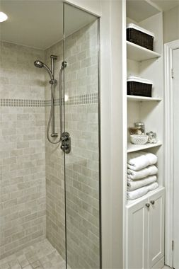 No space left behind    Any unused wall space in a bathroom is an opportunity for storage. Here, a short wall between a shower stall and doorway converts to a built-in cabinet and shelving unit only 20 inches wide. Consider removable shelves and back panel to allow access to pipes and valves for plumbing repairs.