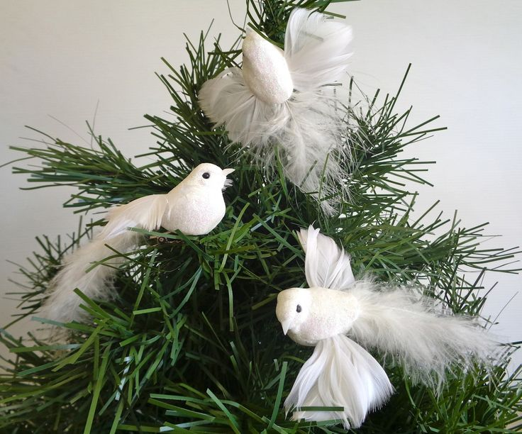 White doves decorating christmas tree