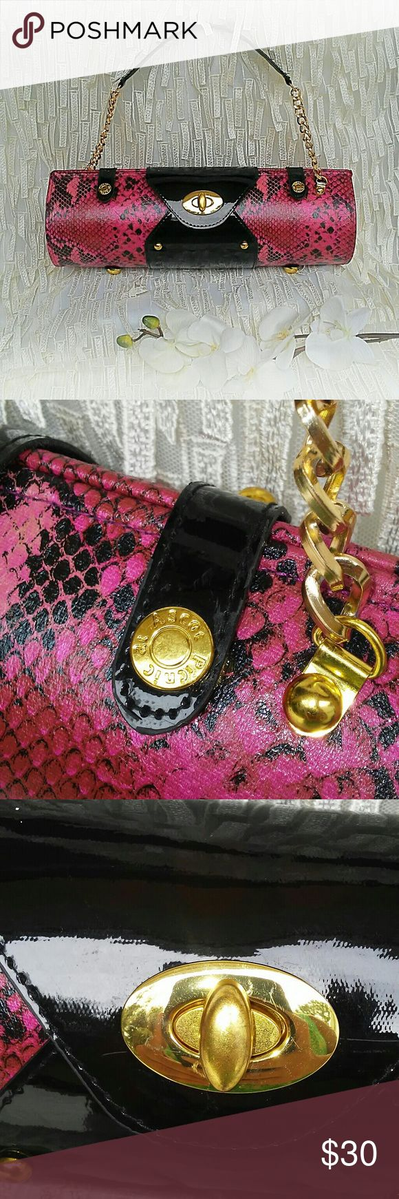 Picnic at Ascot Wine Purse One of a kind high quality wine carrier by Picnic at Ascot. This beautiful hardsided wine purse safely carries one bottle of wine or champagne. Hot pink and black snake skin print with black patent leather accents, gold hardware and chain strap.  NWOT....perfect condition (as seen in photos) Give it as a gift or look uber chic at the next BYOB!!! Picnic at Ascot Bags Travel Bags