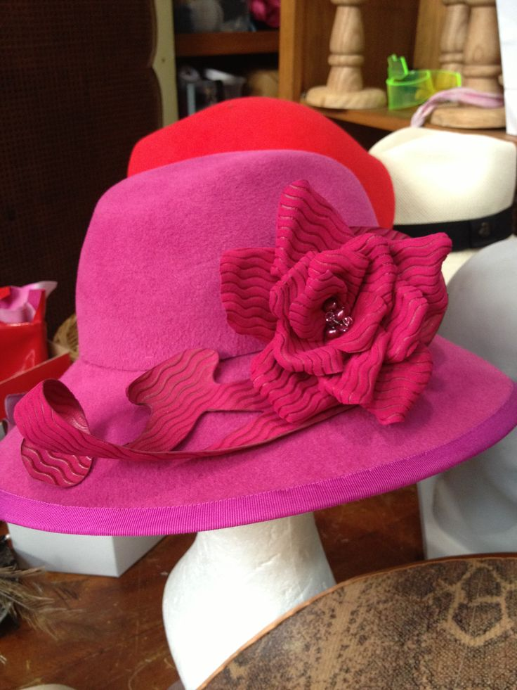Gorgeous magenta furfelt hat with handmade leather flower in progress today