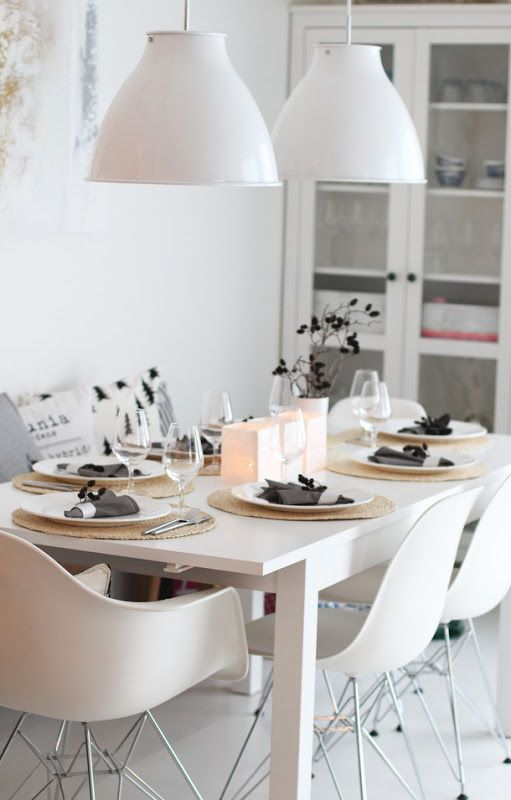 Lovely white Eames chairs for a wonderful cozy minimal family dining room