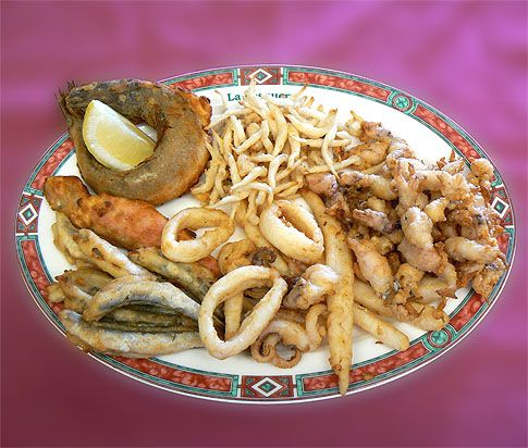 """""""Pescaito frito"""". This traditional fried fish is as much a part of daily life in…"""