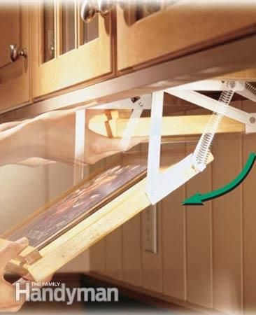 Kitchen Storage Projects That Create More Space - fold down cookbook rack. Corner cupboard roll outs etc.