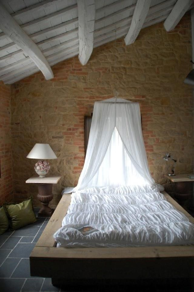 Simple and stunning bedroom with wooden beamed ceilings and exposed brick walls #LeMarche #Italy