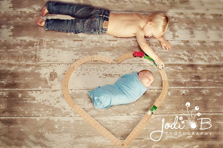 So Sweet. Train heart around baby made by big brother. love!