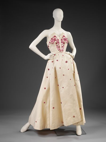 """Evening Dress, Norman Hartnell 1953, satin with bead work. """"Beaded, silk 'crinoline' evening gowns became Norman Hartnell's hallmark. He was at the peak of his career in the mid1950s, when he designed this dress."""