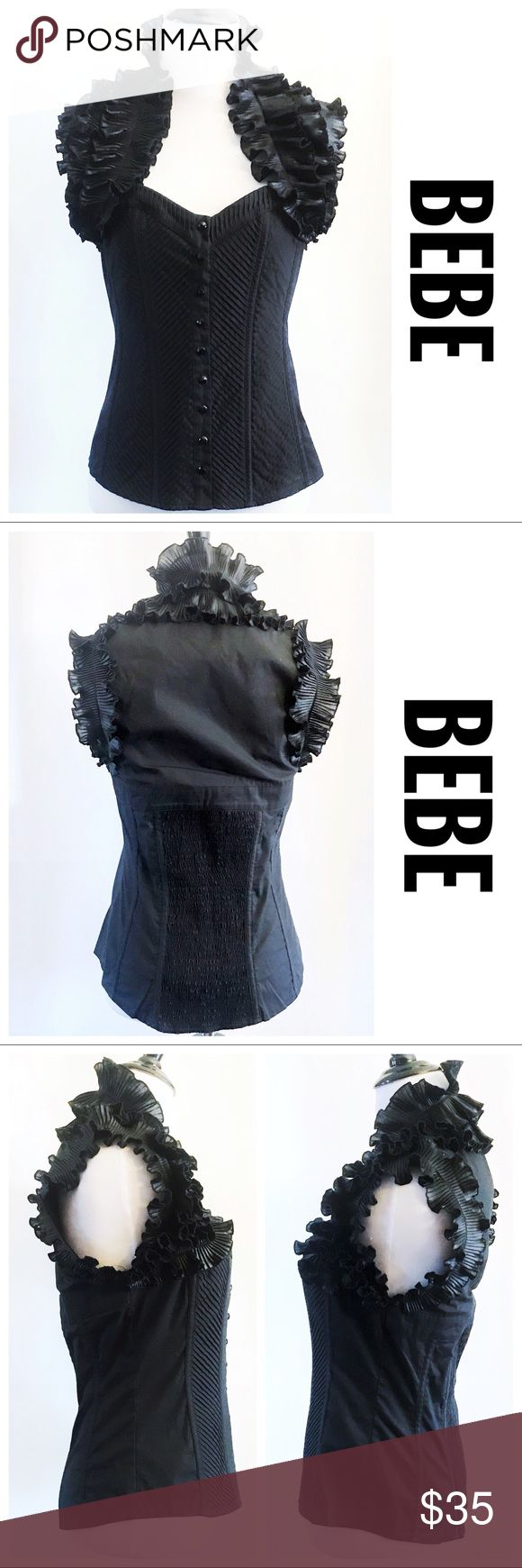 "[BEBE] Black Accordion Ruffle Corset Style Top, M DESCRIPTIONS: BEBE Black Accordion Ruffle Corset Style Top, M - Ruffled accordion details - Black rhinestones Buttons - Sweetheart corset style; Pleated front - Elastic smocking back detail - Sleeveless   MEASUREMENTS (approx.): 25"" Length; 16.5"" Armpit to Armpit.   MATERIALS:  SHELL: 67% Cotton; 28% Nylon; 5% Spandex TRIM: 100% Polyester  Hand wash.   CONDITIONS: Good condition; Shows minor signs of wear. bebe Tops"