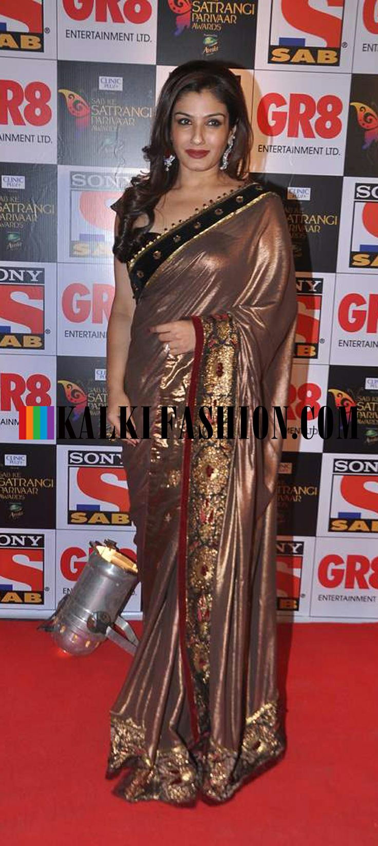 http://www.kalkifashion.com/ Raveena Tandon in a metallic bronze saree at SAB ke Satrangi Parivaar Awards