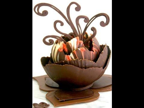 http://www.thechocolateaddict.com  Chocolate Decorating for the Home Chef.  Wow your dinner guests with an edible chocolate dessert cup , great for filling with mousse, fruit or your favorite confections. This technique is with using balloons,  you'll need to experiment with brands of balloons, not all work. Chocolate needs to be tempered first....