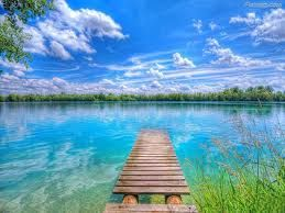 A dock over light blue water
