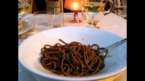Bigoli alla busara is a regional specialty featuring a thick, whole wheat spaghetti and a sauce layered with the flavors of melted anchovies and onions.: Food And Drink, Photo